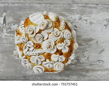 Homemade decorated Serbian slava bread on the rustic wooden board.