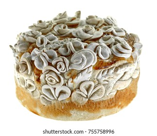 Homemade decorated Serbian slava bread isolated on white background.