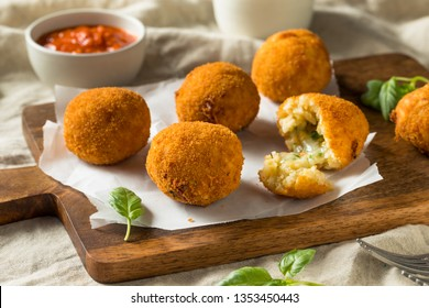 Homemade Deep Fried Risotto Arancini with Basil and Marinara