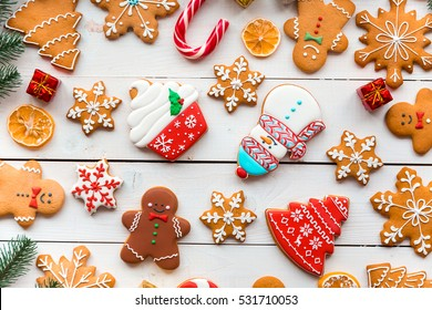 Homemade delicious Christmas gingerbread cookies on the wooden background.