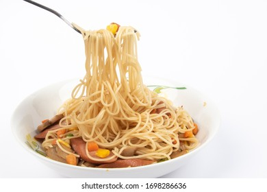 Homemade delicious fried spaghetti on White Background.