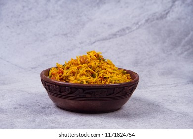 Homemade delicious mutton dum biriyani or pilaf served in cast iron cookware.