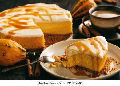 Homemade delicious pumpkin cheesecake with caramel sauce.