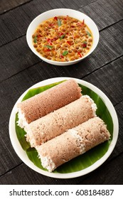 Homemade Delicious red rice Puttu with kadala steamed rice flour with coconut.served with chickpea curry
