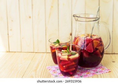 Homemade delicious red sangria with limes oranges, apples and grapefruits