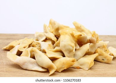 homemade delicious turkish manti ( turkish ravioli ) with yogurt and sauce. isolated turkish manti.