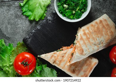 Homemade diet fresh shawarma with greens, chicken breast and tomatoes