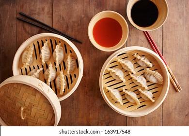Homemade dim-sum asian dumplings on a traditional bamboo steamer