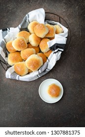 Homemade Dinner Rolls in Bread Basket; One Isolated on White Plate