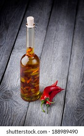 Homemade DIY natural infused olive oil with red chili peppers