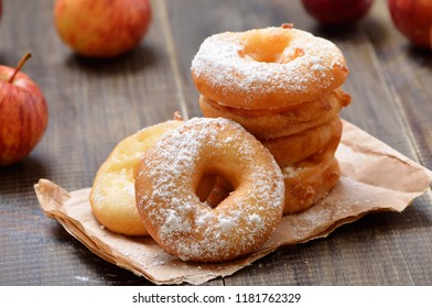 Homemade donuts with apples and powdered sugar, close up