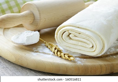 homemade dough  and flour on a wooden board