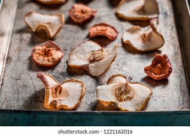 Homemade dried apples on old baking tray