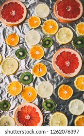 Homemade dried slices of various citrus fruits on a silver background. Many Orange lemon grapefruit.