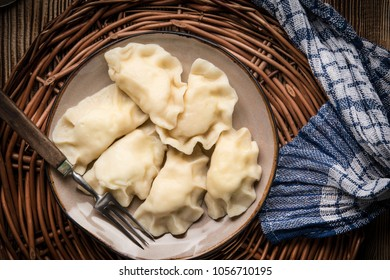 Homemade dumplings with cheese on a plate. Top view.