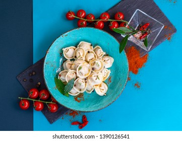 Homemade dumplings - Russian dumplings with meat, ravioli. Dumplings with stuffing. Japanese-style dumplings with peppers and tomatoes.