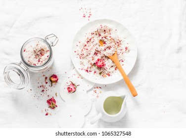 Homemade edible coconut rose sugar scrub on light background, top view. Making home product cosmetics concept. Flat lay