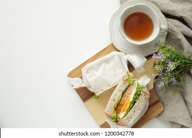 homemade egg and bacon sandwich with tea