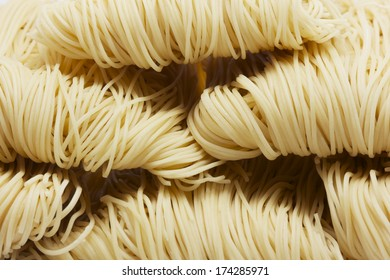 homemade egg noodles, isolated on white background