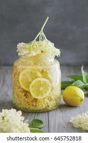 Homemade Elderflower Syrup. Elderflower syrup being made with lemon slices.