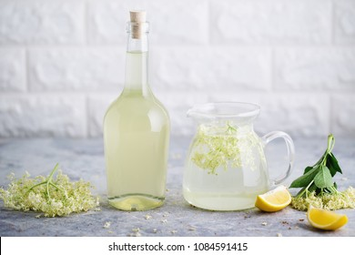 Homemade elderflower  syrup with freshly picked elderflowers. The flowers are edible and can be used to add flavour and aroma to both drinks and desserts.