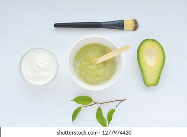 Homemade face mask with avocado and yogurt, natural organic ingredients, top view.