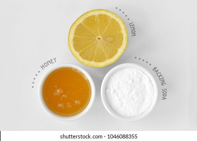 Homemade face mask made out of lemon juice, honey and baking soda on white background