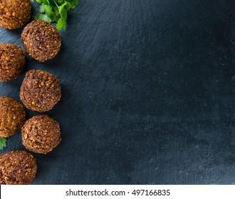 Homemade Falafel (close-up shot; selective focus) on wooden background