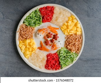 Homemade festive cuisine / Fish-Shaped Vegetarian Prosperity Toss / Made entirely of vegetables and fruits. In chinese belief fish or yu mean abundance and prosperous