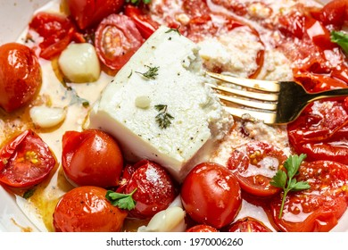Homemade feta pasta, oven baked cherry tomatoes and feta cheese with olive oil, Food recipe background. Close up.