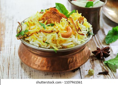 Homemade Fish Biryani in a traditional Brass pot / Ramadan Food