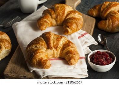 Homemade Flakey French Croissants on a Background