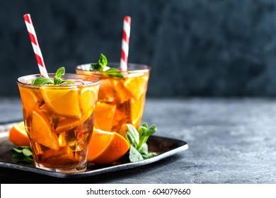 homemade flavored orange iced tea, refreshing summer beverage