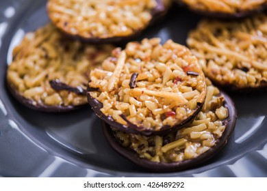 Homemade florentines cakes with chocolate on plate