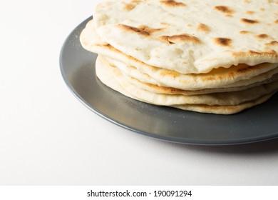 Homemade flour tortillas, served on a plate