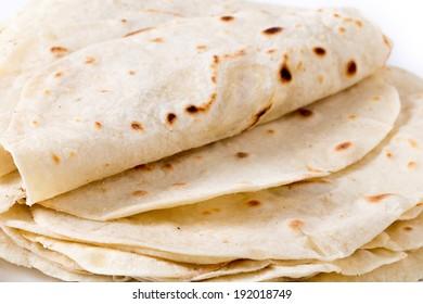 Homemade flour tortillas viewed close-up.