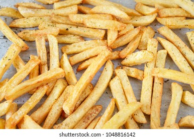 Homemade french fries on a tray background, closeup shot