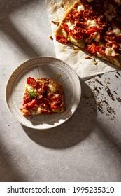 Homemade French open pie quiche with zucchini, tomatoes, mozzarella and bacon.