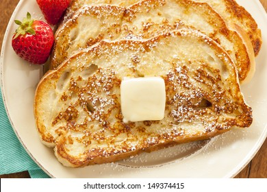 Homemade French Toast with Butter and Powdered Sugar