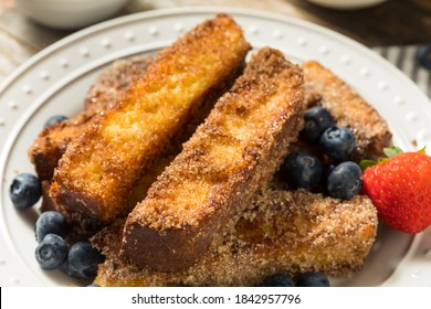 Homemade French Toasts Sticks with Syrup and Fruit