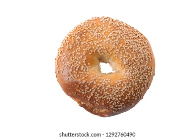 Homemade fresh bagel with sesame seeds and sea salt. Isolated on white background.