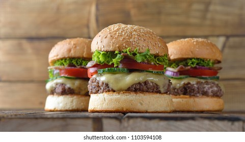 Homemade fresh cheeseburger on a brown background