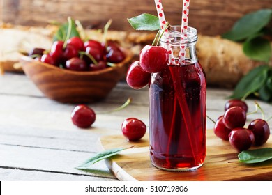 Homemade fresh cherry juice in a bottle. Rustic style. Healthy and diet food. Selective focus
