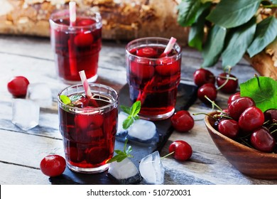 Homemade fresh cherry juice in a glass. Rustic style.Healthy and diet food. Selective focus