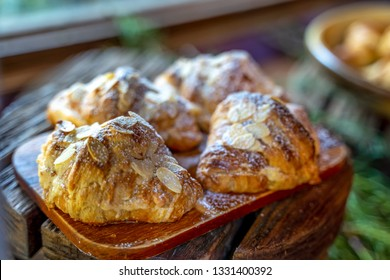 Homemade Fresh croissant with almonds on the plate