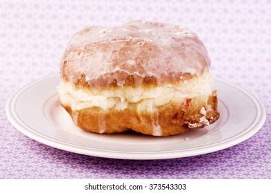 Homemade fresh donut, doughnut on a plate.
