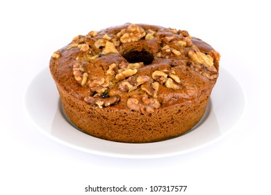 Homemade fresh honey cake with nuts on dish.