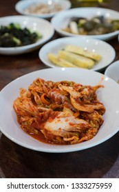 homemade fresh kimchi and other Korean side dishes like eggs rolls, spinach, sweet potato