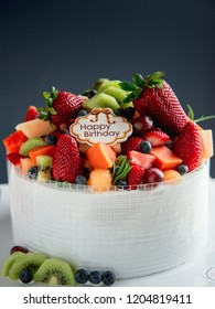 Homemade Fresh Mix Fruits cake with Happy birthday tag.