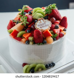 Homemade Fresh Mix Fruits Cake With Happy Birthday Tag